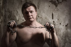 Man with a chain tied hands Royalty Free Stock Photos
