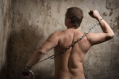 Man with a chain tied hands Stock Photography