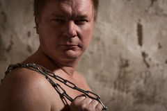 Man with a chain tied hands Royalty Free Stock Photography