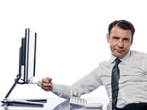 Man chained to computer with handcuffs sad Royalty Free Stock Image