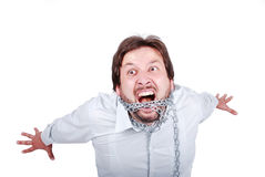 Man in chains. Young casual caucasian man chained and screaming Royalty Free Stock Image