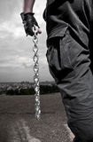 Man with chains Stock Photo