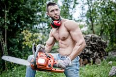 Man with chainsaw Royalty Free Stock Photos