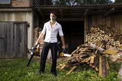 Man with chainsaw. Dangerous man with chainsaw in the evening stock image