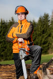Man with chainsaw. A man with a chainsaw outdoor royalty free stock images
