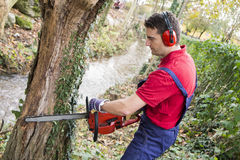Man with chainsaw Stock Photography
