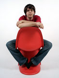 Man on a chair. Man on a orange chair stock photography