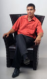 A man and a chair. Royalty Free Stock Photography