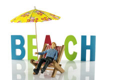 Man in chair on the beach Stock Photos