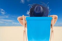 Man in chair at the beach Stock Photos