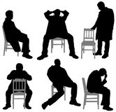 Man on chair Stock Images