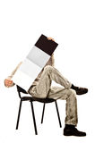 Man in a chair with a magazine Royalty Free Stock Photos