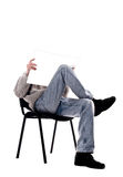 Man in a chair with a magazine Royalty Free Stock Image