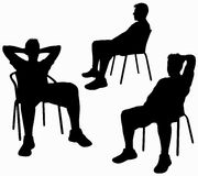 Man on chair silhouette Stock Photos