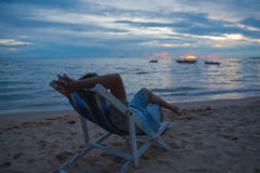 Man on chairs with Beautiful sunset and sky of the sea, perfect sky and water. Stock Photography