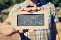 Man with a chalkboard with the text emotional intelligence Royalty Free Stock Image