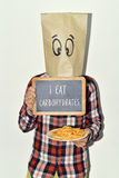 Man with chalkboard with text I eat carbohydrates Royalty Free Stock Photo