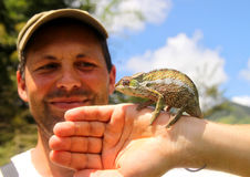 Man and chameleon Stock Photo