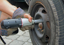 Man change a car tyre Stock Image