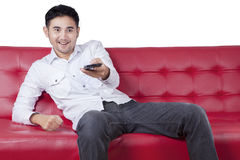 Man change tv channel with cellphone Stock Photos