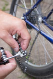 Man changes bicycle chain Royalty Free Stock Image