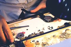 Working with a watch. A man changing the battery of my watch royalty free stock images