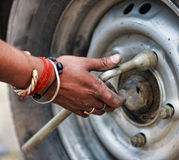 Man changing the car wheel on the road,  close up Stock Image