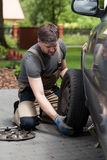 Man changing car wheel Stock Photo