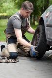 Man changing car wheel Royalty Free Stock Images