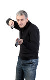 Man changing channel with a remote control Stock Image