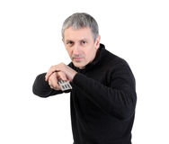 Man changing channel with a remote control Stock Photography