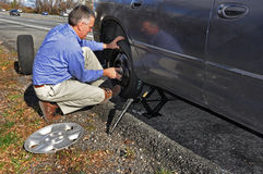 Man changing flat tire Royalty Free Stock Photography