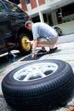 Man changing his car tyre Royalty Free Stock Image
