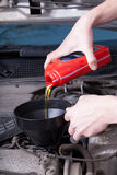 Man changing motor oil Stock Photography
