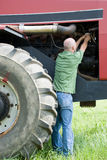 Man changing oil filter on large engine stock image