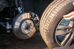 Man is changing summer car wheel, tire before winter royalty free stock photos