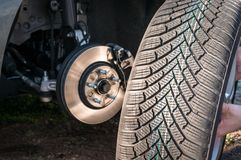 Man is changing summer car wheel, tire before winter stock photos