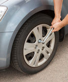 Man changing tire. Transportation and vehicle concept - man changing tire Royalty Free Stock Image