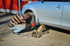Man changing tires on the car Royalty Free Stock Photos