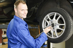 Man changing tires in the garage Royalty Free Stock Photos