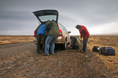 Man changing wheel Royalty Free Stock Photo