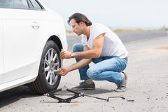 Man changing wheel after a car breakdown Stock Image