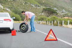 Man changing wheel after a car breakdown Stock Photo
