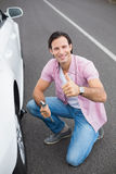 Man changing wheel after a car breakdown Royalty Free Stock Photo
