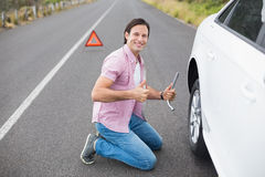 Man changing wheel after a car breakdown Stock Images