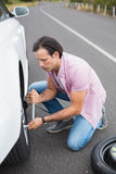 Man changing wheel after a car breakdown Stock Photography