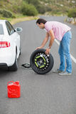 Man changing wheel after a car breakdown Royalty Free Stock Image