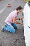 Man changing wheel after a car breakdown Stock Photos