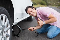 Man changing wheel after a car breakdown Royalty Free Stock Photography