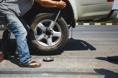 A man changing the wheel. At the side of the road Royalty Free Stock Photography